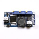 [016]  Модуль: DC/DC пониж.; вх. 3,0-40V - вых. 1,3-35V, до 2А (на LM2596) c 2-мя регул.зарядного и максим.тока, 98119